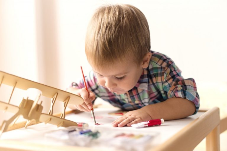 a child doing arts and crafts
