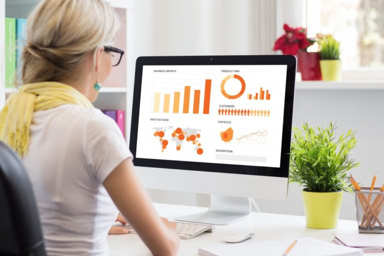 woman looking at business charts and graphs