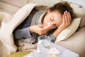 Girl with colds lying down on couch