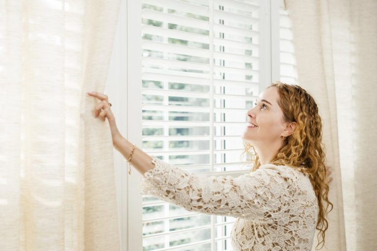 girl beside window