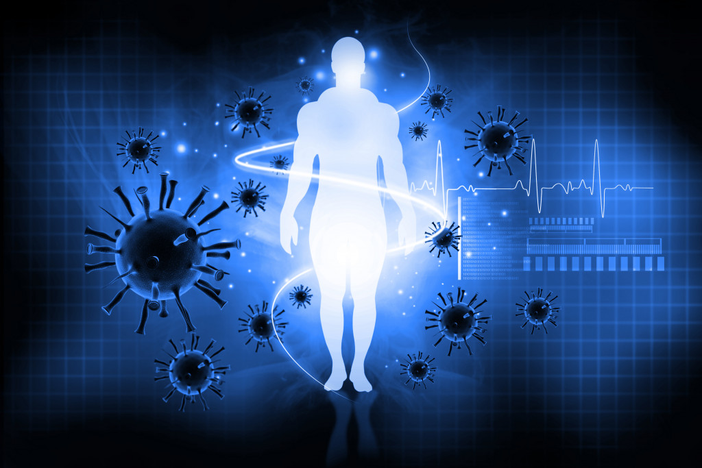 an illustration of a person and viruses