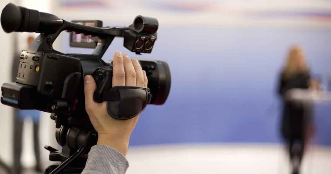 person using a video camera