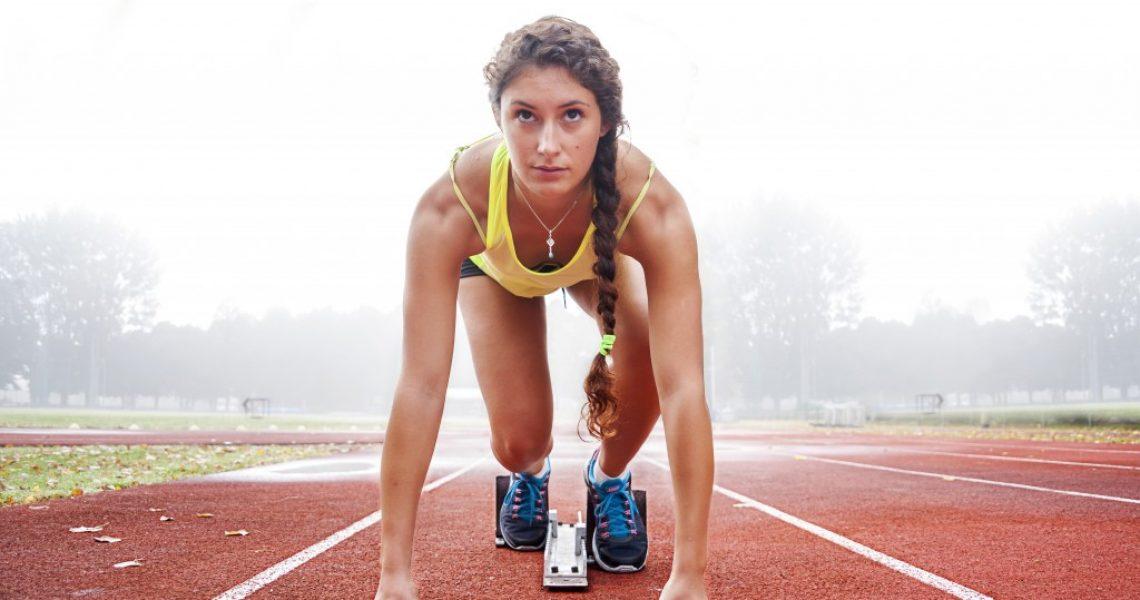 female runner at the start point of track